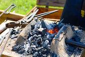 Blacksmith at working process — Stock Photo