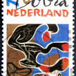 Cobra artist on an dutch post stamp — Stock Photo