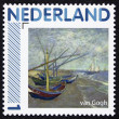 Stamp with a picture of boats on the beach painted by Vincent van Gogh — Stock Photo