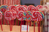 Colored lollipop in a row — Stock Photo