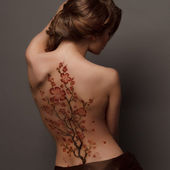A beautiful woman, back view — Stock Photo