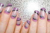 Female hands with beautiful manicure in gentle tones. — ストック写真