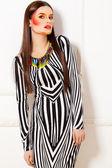 Beautiful fashion woman color face art — Stock Photo