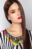 Color de la cara hermosa mujer de la manera del arte — Foto de Stock