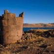 Stock Photo: Sillustani in Peru with deep blue lake in bg