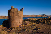Sillustani in Peru with deep blue lake in the bg — Stock Photo