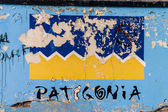 Patagonia graffiti on a wall in Puerto Natales — Stock Photo