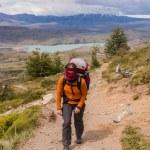 Women trekking in Torres del Paine strong wind blowing — Stock Photo #22090125