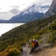 Torres del paine in Chilean National Park Los Cuernos trekking woman resting - Stock Photo