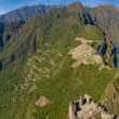 Machu picchu with both trekking paths - Stock Photo