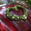 Stock Photo: Flower bouquet in heart shape on oldtimer car