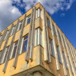 Stock Photo: Run-down building with blue sky and clouds HDR