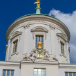 Detail of the old town hall of Potsdam in Germany Atlas carrying the world — Stock Photo