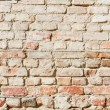Stock Photo: Bedraggled brick wall in dusted yellow