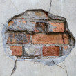 Stock Photo: Hole in wall red bricks looking out detail