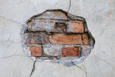 Hole in a wall red bricks looking out detail — Stock Photo