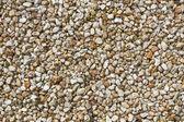 Pequeños guijarros marrón y amarillos — Foto de Stock