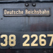 Stock Photo: Sign on old germlocomotive