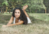 Portrait of the girl on the grass — Stock Photo