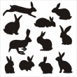 Easter bunny silhouettes — Stock Vector #24124613
