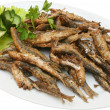 Stock Photo: Fried sprats with lettuce