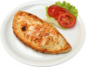Pizza Calzone with salami bacon cheese and mushrooms — Stock Photo
