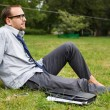 Young businessman on grass — Stock Photo