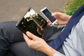 Businessman holding mobile phone and tablet — Foto de Stock