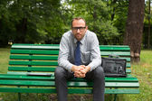 Businessman sitting on bench — Stock Photo