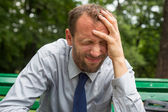 Businessman  having headache — Stock Photo