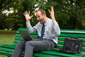 Excited businessman with laptop — Стоковое фото