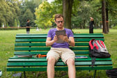 Student with tablet and phone — Stock Photo
