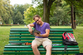 Student on bench — Stock Photo