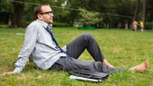 Young businessman on grass — Stockfoto