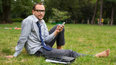 Businessman chatting on cell phone — Стоковое фото