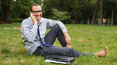 Happy businessman on grass — Foto Stock
