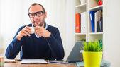 Caucasian man with coffee — Stock Photo