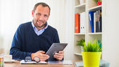 Young man in office — Stock Photo