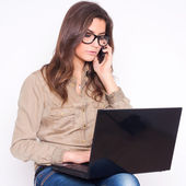 Young woman working on laptop — Foto Stock