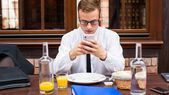 Businessman with smartphone — Stock Photo
