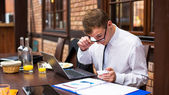 Hard working businessman — Stock Photo