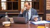 Hard working businessman — Stock Photo
