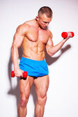 Guy doing exercises with dumbbells — Stock Photo