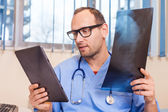 Doctor with tablet and x-ray picture — Stock Photo