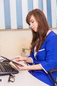 Female doctor using tablet — Stock Photo