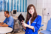 Nurse with tablet in hospital — Stock Photo