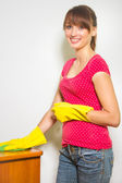 Woman with gloves and rag — Stock Photo