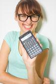 Woman holding calculator — Stock Photo