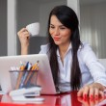 Businesswoman having coffee break — Stock Photo