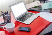 Workplace with mobile phone and laptop — Stock Photo